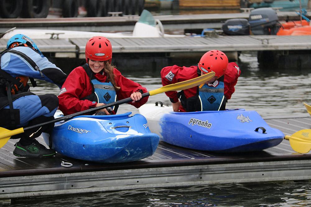 two women getting into canoe's