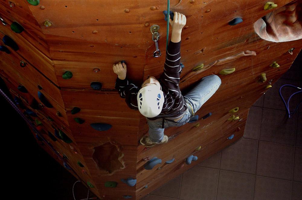 A boy climbing on a climbing walk