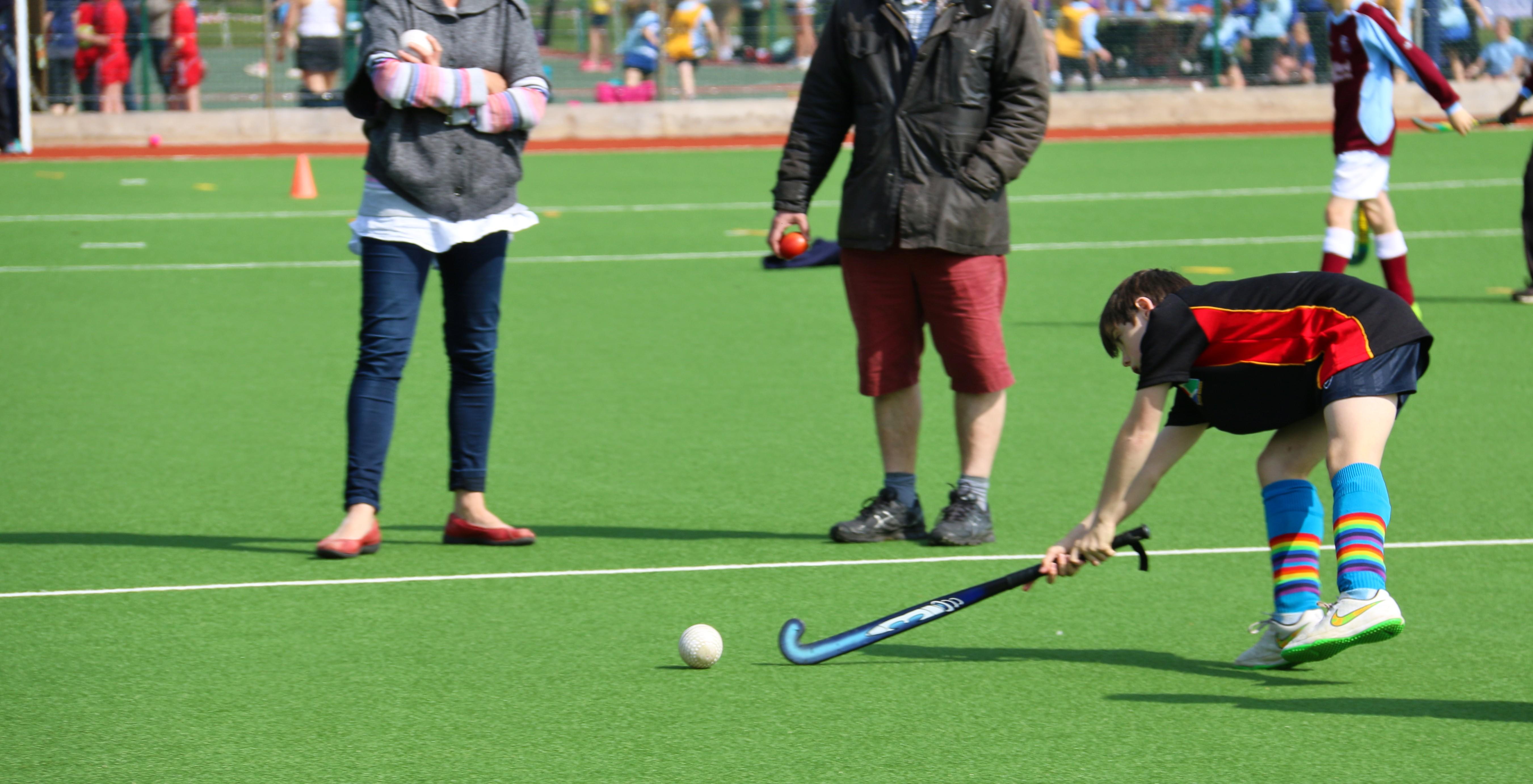Boy hitting a hockey ball