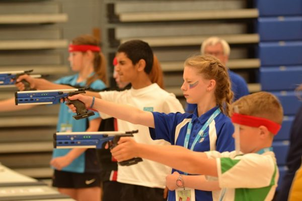 A group of young people target shooting