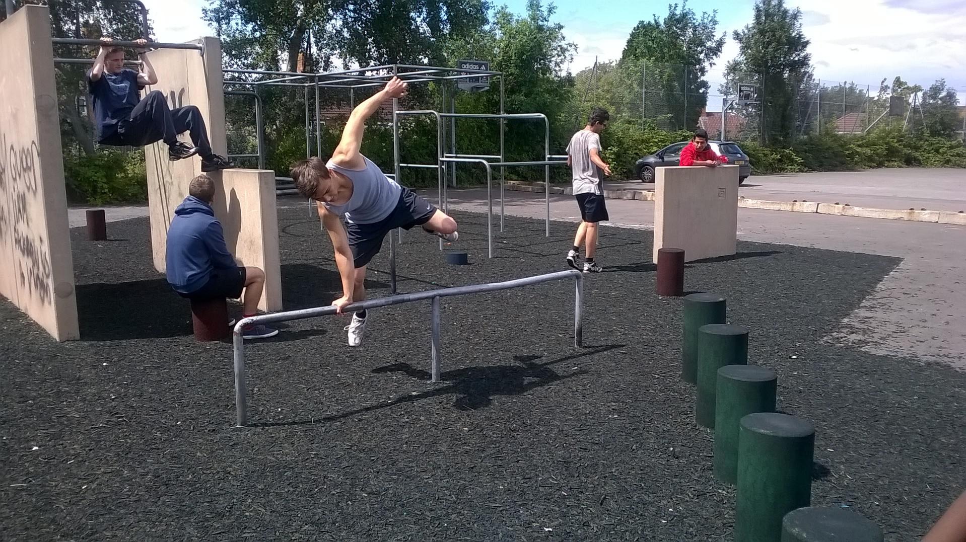 A young man jumping over an obstacle